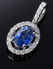 Sale 8902H - Lot 108 - AN 18CT WHITE GOLD SAPPHIRE AND DIAMOND PENDANT; centring an approx. 0.82ct blue oval sapphire to surround and bale set with 25 roun...