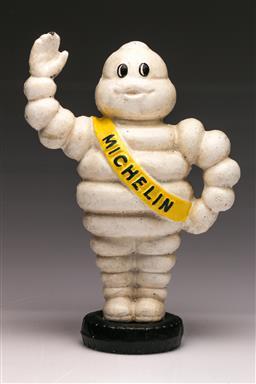Sale 9114 - Lot 71 - Cast iron reproduction Michelin man themed money box (H:23cm)