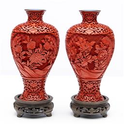 Sale 9245R - Lot 95 - A pair of deep carved cinnabar vases C: 1930s, carved with floral sprays on a deep hatched ground within compartments, with a blue ...