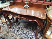 Sale 8868 - Lot 1080 - Victorian Mahogany Side Table, with gallery back & serpentine front, fitted with a drawer & on cabriole legs