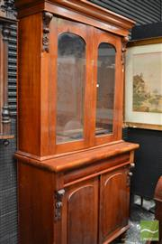 Sale 8460 - Lot 1032 - Late 19th Century Cedar Bookcase, with two glass panel doors, a long drawer & two arched panel doors