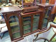 Sale 8539 - Lot 1063 - Victorian Mahogany Dwarf Breakfront Bookcase, with four glass panel doors, the taller outside doors arched and with corbels, raise...