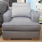 Sale 8709 - Lot 1011 - A comfortable square form lounge chair and matching cushion, in a geometric weave in blue and white, Height of back 80cm, W x 86cm