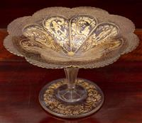 Sale 8963H - Lot 61 - A good C19th continental cut and gilt tazza with alternating panels of knights and grotesque scrolls, Height 16cm