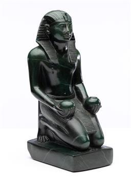Sale 9245R - Lot 99 - A reproduction figure of Tutankhamun by Alba Museum Copyright replicas, New York. Ht: 27cm