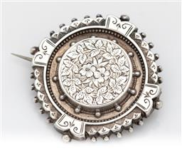 Sale 9245R - Lot 100 - An antique English sterling silver brooch, C: 1900, the fancy scalloped and ball edge framing the hand engraved floral centre, D: 4cm