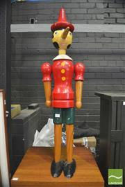 Sale 8310 - Lot 1025 - A Large Timber Pinocchio Articulated Model, height 100cm