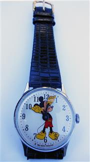Sale 8387A - Lot 21 - A vintage Mickey Mouse mechanical hand wind wristwatch by Walt Disney Productions. 32 mm. Clean watch in running condition