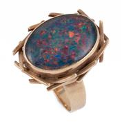 Sale 8866 - Lot 334 - A VINTAGE 9CT GOLD OPAL RING; rub set with an oval opal triplet in birds nest surround, size O1/2, wt. 7.27g.