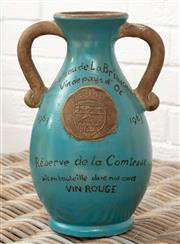 Sale 9066H - Lot 204 - A large French red wine flagon in terracotta with teal glaze, Height 31cm