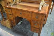 Sale 8317 - Lot 1050 - 18th Century Style Italian Inlaid Walnut Desk, with seven drawers, inlaid panels to back & tapering legs (some faults)
