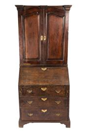 Sale 8599A - Lot 100 - An early-mid Georgian oak secretaire bookcase of diminutive proportions. The two panelled doors revealing two shelves above pigeon h...