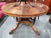 Sale 8848 - Lot 1073 - Regency Rosewood Supper Table, the round top on birdcage base & quadraform platform with outswept legs