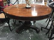 Sale 8868 - Lot 1065 - Regency Rosewood Tilt Top Supper Table, the round top on a turned pedestal with reeded collar & quadraform base