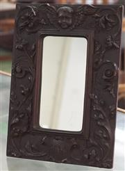 Sale 8319 - Lot 326 - Carved wood frame with cherub and scrolling foliage dated 1906