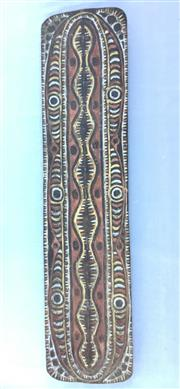 Sale 8579 - Lot 44 - A Large Papua New Guinea Sepik River war shield carved from one solid piece from upper Sepik Region, H 197 x W 48cm