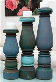 Sale 8990H - Lot 9 - A set of three graduated timber and blue painted balluster candlestics and pottery barn candles, tallest 59cm