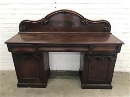 Sale 9097 - Lot 1033 - Early Victorian Mahogany Double Pedestal Sideboard, with carved shaped back, three cushion shaped drawers & two carved panel doors