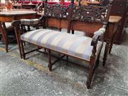Sale 8868 - Lot 1087 - Renaissance Style Heavily Carved Walnut Settee, the back with panel & strap-work & lion head terminals, above a blue striped fabric...