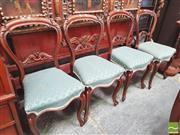 Sale 8428 - Lot 1057 - Set of Four Carved Rosewood Chairs, with balloon backs, scale pattern upholstery & cabriole legs