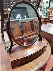 Sale 8814 - Lot 1077 - Victorian Inlaid Mahogany Toilet Mirror, in the Regency style, with oval mirror, bow front & three drawers (faults)
