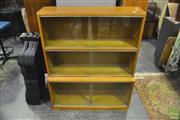 Sale 8361 - Lot 1014 - 1960s oak stacking bookcase w/sliding glass doors