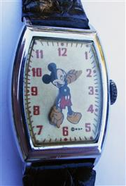 Sale 8387A - Lot 27 - A vintage Mickey Mouse wristwatch in Art Deco chrome tank shaped case. Made by US time. Hand winding. 33 x 27 mm case. Running condi...