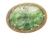 Sale 8451J - Lot 388 - A 14CT GOLD NEPHRITE PENDANT; 30 x 20mm carved nephrite to triple rope border, wt. 9.7g.