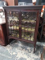 Sale 8868 - Lot 1015 - Edwardian Carved Mahogany Display Cabinet or Vitrine, with two astragal panel doors enclosing an emerald velvet interior, on taperin...