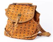 Sale 8910F - Lot 32 - An MCM tan leather fold over monogram backpack, stamped H9823
