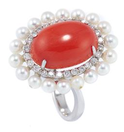 Sale 9083 - Lot 372 - AN 18CT WHITE GOLD CORAL DIAMOND AND PEARL COCKTAIL RING; featuring a 5.8ct oval cabochon coral (13.9 x 9.8mm) four claw set above a...