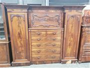 Sale 9031 - Lot 1004 - William IV Mahogany Gentlemans Breakfront Wardrobe, the scroll framed cabinet, above six drawers within a moulded frame, flanked by...