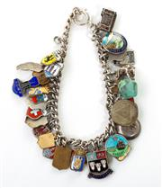 Sale 8731 - Lot 320 - A STERLING SILVER CHARM BRACELET; curb bracelet with bolt ring clasp attached with assorted charms mostly enamelled, length 20cm, wt...