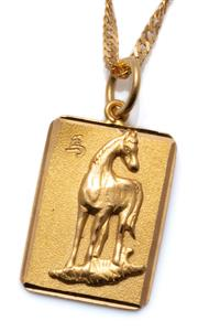 Sale 9037 - Lot 308 - A 22CT GOLD PENDANT NECKLACE; twisted flat curb chain with scroll clasp attached with an 18 x 13mm disc featuring a horse, length 45...