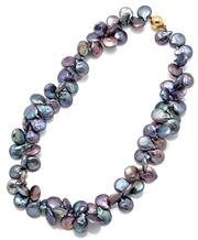 Sale 9101 - Lot 2100B - A BUTTON PEARL NECKLACE; 10mm round cultured black keshi pearls with peacock overtones to 9ct gold ball clasp, length 42cm.