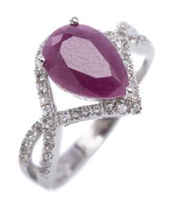 Sale 9213 - Lot 389 - A SILVER RUBY AND STONE SET RING; claw set with a pear cut ruby of approx. 2ct to bypass surround and split shoulders set with zirco...