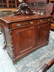 Sale 8714 - Lot 1017 - 19th Century Probably Dutch Rosewood Credenza, with well carved vase & fruit backboard, with two drawer s& two panel doors (key in o...