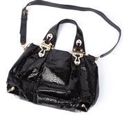 Sale 8910F - Lot 15 - A Michael Kors black faux snakeskin handbag with statement hardware