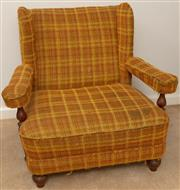 Sale 8976H - Lot 97 - An early 20th century walnut wing backed armchair upholstered in a wool tartan fabric. Height of back 85cm