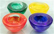 Sale 8990H - Lot 44 - A set of four glass Kosta Boda tealight holders in bright swirled colours