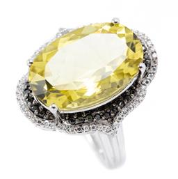 Sale 9169 - Lot 332 - A SILVER GEMSET COCKTAIL RING; featuring an oval cut citrine to double surround of black and white round cut zircons, top 22.51 x 20...