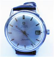 Sale 8387A - Lot 33 - A vintage mens Omega Seamaster automatic wristwatch. 34.5 mm. Stainless case. Excellent condition.