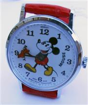 Sale 8387A - Lot 34 - An early Swiss made Mickey Mouse wristwatch. Chrome finish case with red plastic strap. Manual wind. Running condition. 33.7 mm.