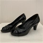 Sale 8694A - Lot 68 - A pair of Paul Green Perk black patent leather cross strap peep-toe heels, DE size 5.5