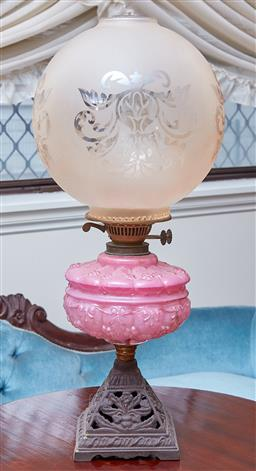 Sale 9103M - Lot 477 - A tall kerosene lantern with pink glass mid-section, total Height 57cm