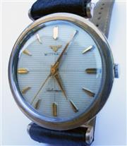 Sale 8387A - Lot 35 - A vintage mens Wittnaur automatic wristwatch. 10K gold filled case. 34 mm. Running fine.