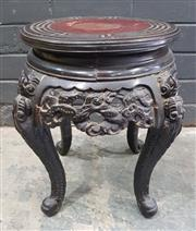 Sale 9031 - Lot 1050 - Japanese Meiji/ Taisho Ebonised Pedestal, with red top within key border, the apron & cabriole legs carved with dragons (h:39 x d:30cm)