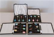 Sale 8369A - Lot 88 - Four English made boxed sets of enamel and silver gilt coffee spoons with bean terminals