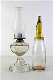 Sale 8944 - Lot 12 - Vintage oil bottle together with a kerosene lamp