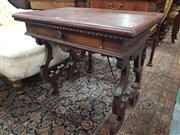 Sale 8917 - Lot 1057 - Small Renaissance Style Walnut Occasional Table, in the Spanish guardroom style, fitted with a drawer & lyre shaped supports joine...